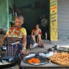 Patna: An elderly woman tends a food stand