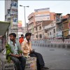 Patna: Men relax on the streets of the city after a hard day's work