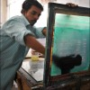 Patna: A printer prepares a screen printing machine