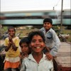 Patna: Children play as a local NGO drills a new well in their slum