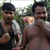 Patna: Two men wait as a local NGO drills a new well in their slum