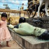 Battambang: A young girl plays in a Buddhist cemetery