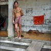 Battambang: A man stands outside his home, an abandoned train depot