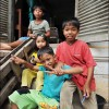 Battambang: Children relax on the steps of their home