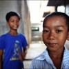 Battambang: Two boys pose outside their home, an abandoned soft drink factory