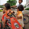 Battambang: Children play outside their home, an abandoned soft drink factory