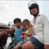Battambang: A young family pulls in to the city's central market