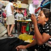 Phnom Penh: A textiles vendor grabs a quick bite at Olympic Market