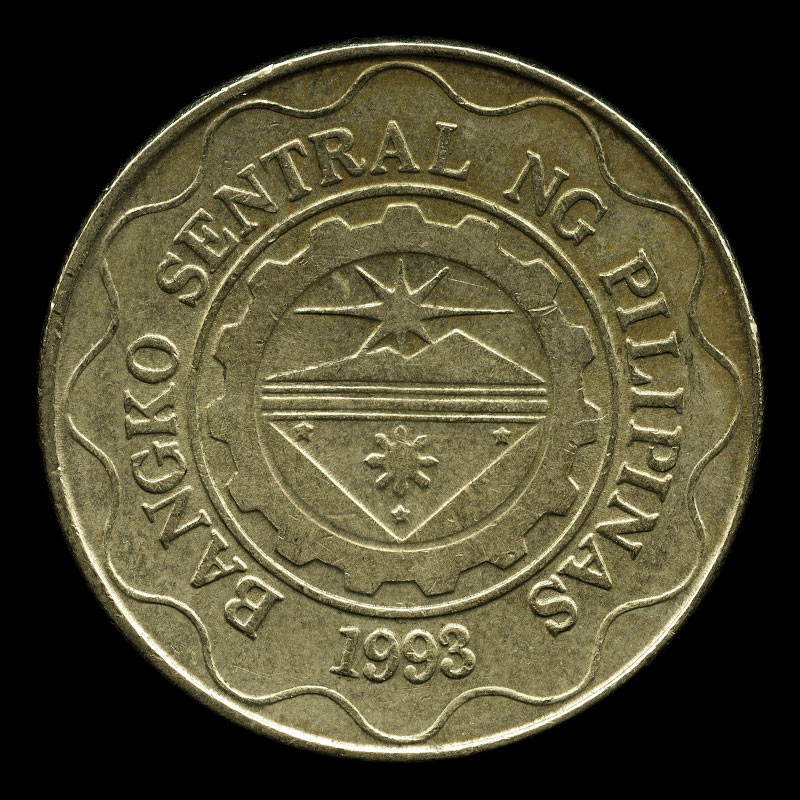 a five Philippine peso coin featuring a portrait of Emilio Aguinaldo and the logo of the Central Bank of the Philippines