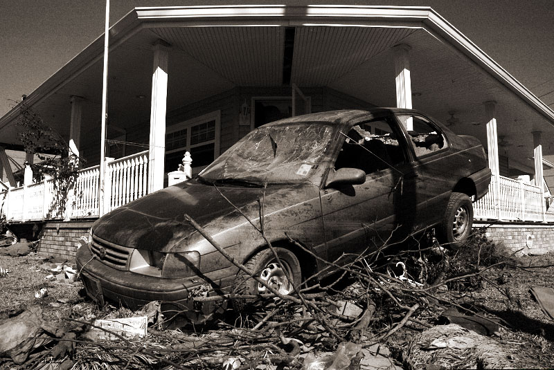 a Toyota Tercel comes to rest on a pile of debris in the aftermath of Hurricane Katrina