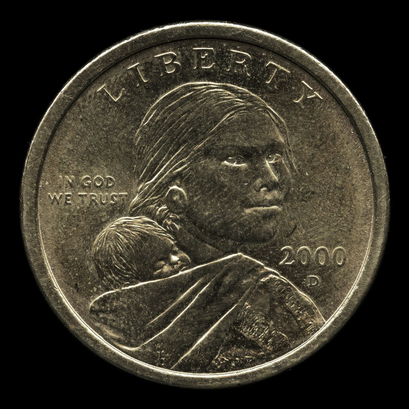 a US one dollar coin featuring a portrait of Sacagawea on one side and a bald eagle in flight on the other