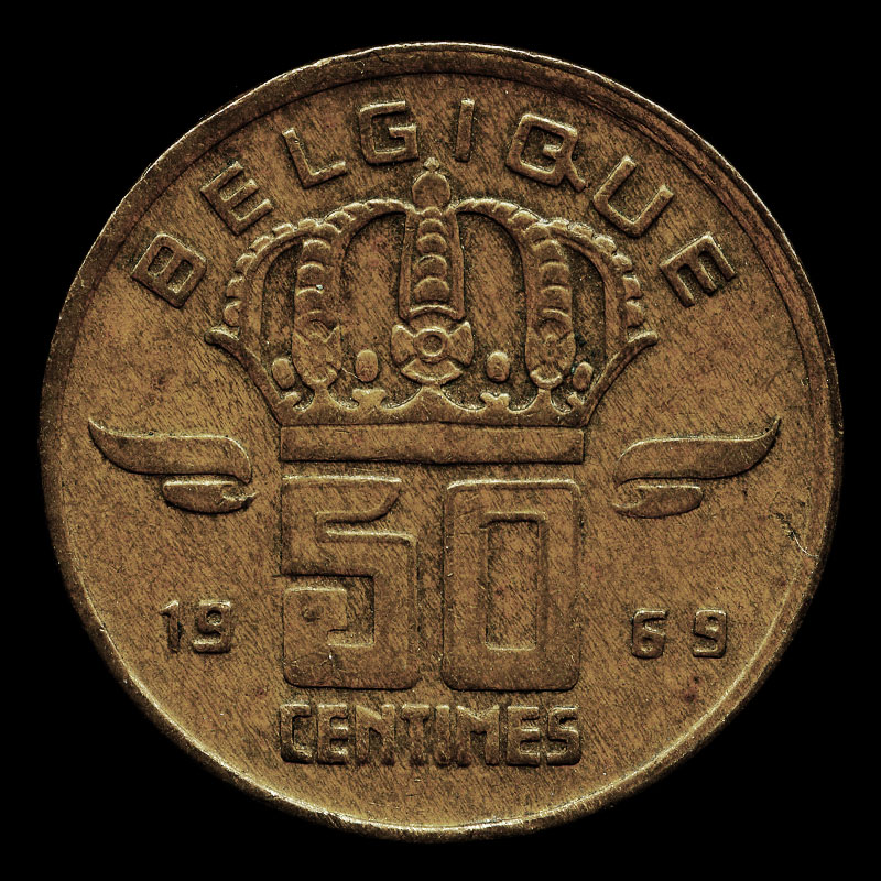an obsolete 50 centimes coin from Belgium featuring a portrait of a coal miner with a Davy safety lamp