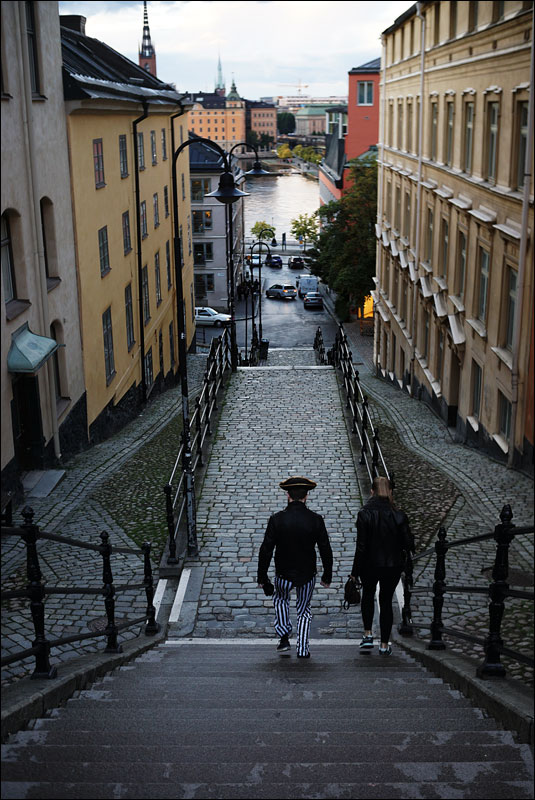a man dressed as a pirate trundles down some steps in Södermalm