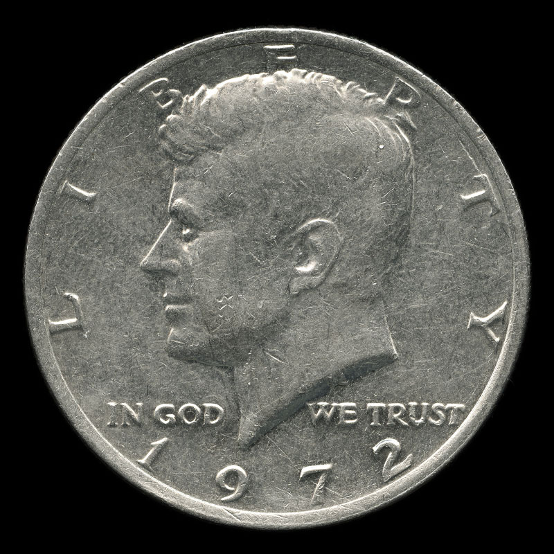an American 50 cent coin bearing the portrait of John F. Kennedy on one side and the bald eagle on the other