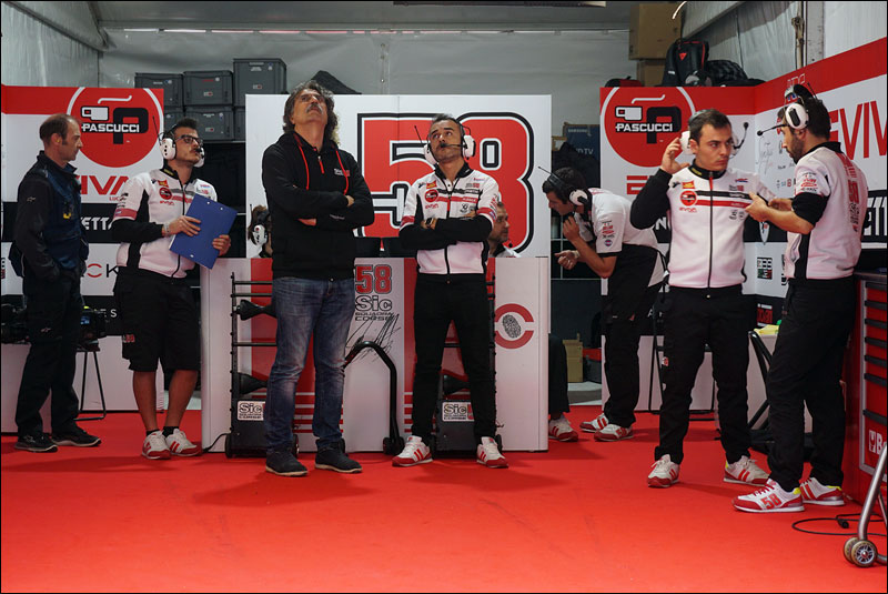 Paolo Simoncelli (center left), Sic58 Squadra Corse Moto3 boss and father of the late MotoGP Legend Marco Simoncelli, looks on during practice at the 2018 Motorcycle Grand Prix of the Americas