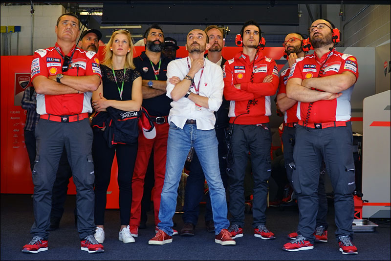 Ducati CEO Claudio Domenicali (center) and Ducati Corse crew members watch the MotoGP race at the 2018 Grand Prix of the Americas