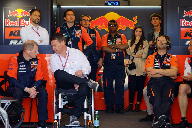 KTM Moto2 team boss Aki Ajo (far left) speaks with KTM Motorsports Director Pit Beirer during the 2018 Grand Prix of the Americas