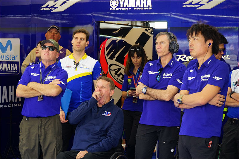 MotoGP legends Kenny Roberts Sr. (sunglasses) and Wayne Rainey (yawning) watch alongside Yamaha MotoGP boss Lin Jarvis (headset) at the 2018 Grand Prix of the Americas