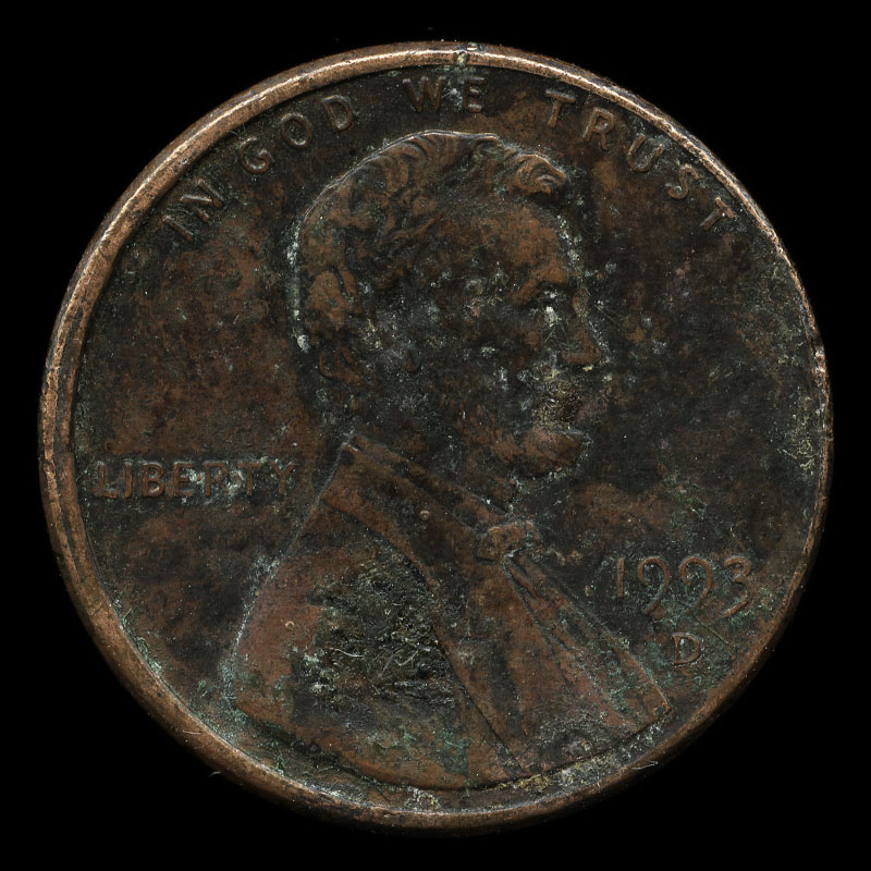 a weathered American one cent coin featuring Abraham Lincoln on one side and the Lincoln Memorial on the other