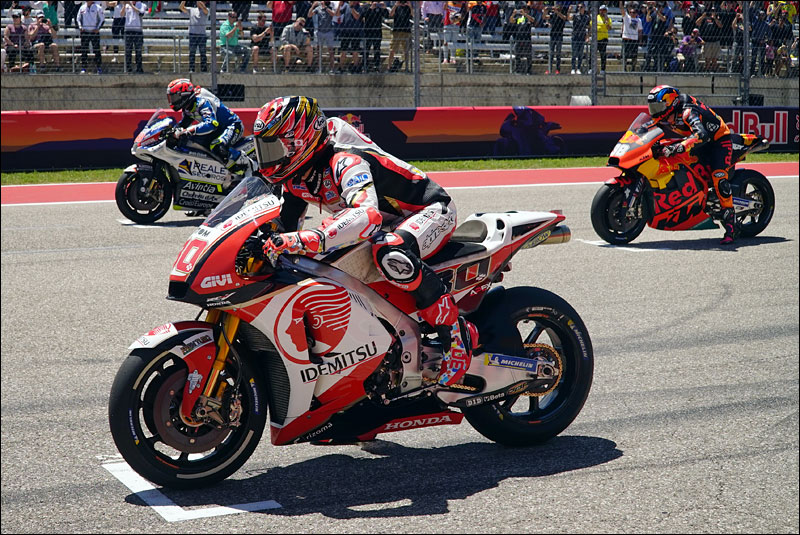 MotoGP riders Tito Rabat, Takaaki Nakagami, and Bradley Smith wait for the lights to go out at the 2018 Grand Prix of the Americas