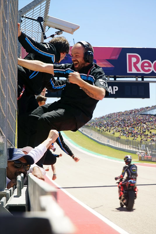 Italian Moto2 rider Francesco 'Pecco' Bagnaia's team celebrates his victory as he crosses the finish line at the 2018 Grand Prix of the Americas