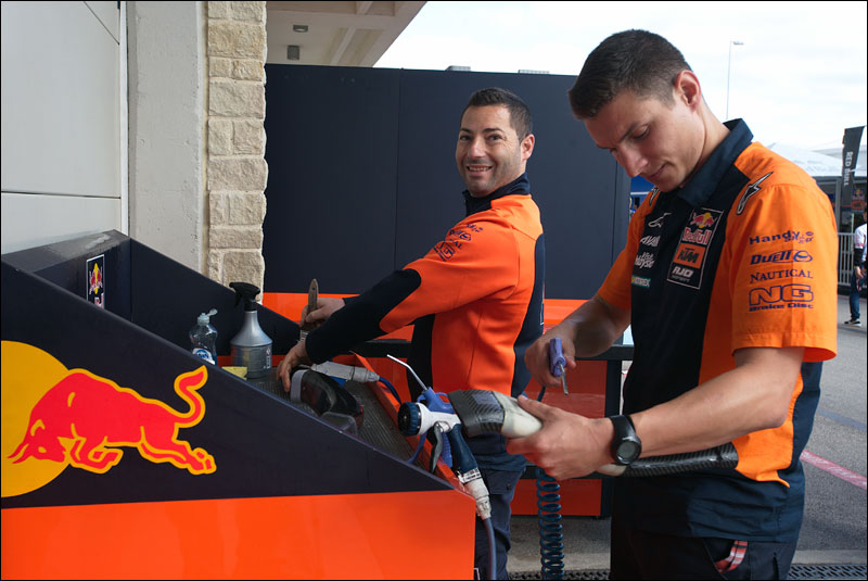 members of the Red Bull KTM MotoGP team wash down parts after practice at the 2018 Motorcycle Grand Prix of the Americas