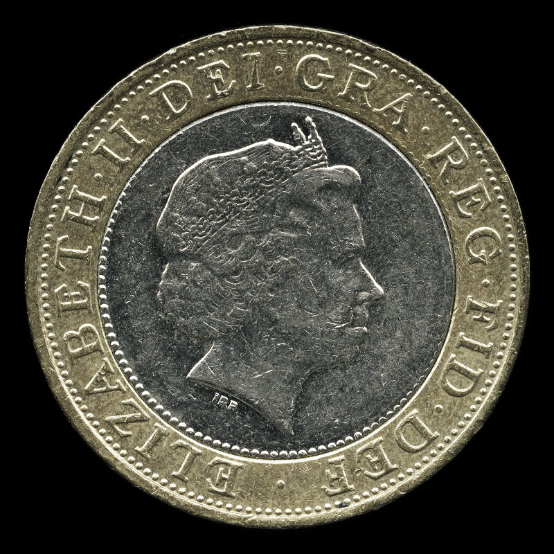 a British two pound coin featuring a portrait of Queen Elizabeth II on one side and a design that commemorates the history of technological advancement on the other