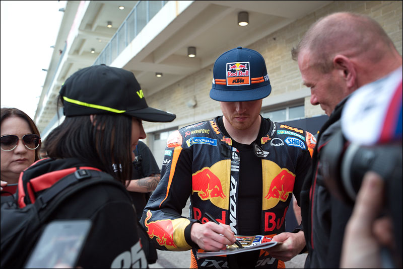British MotoGP rider Bradley Smith takes time to sign autographs at the 2018 Motorcycle Grand Prix of the Americas