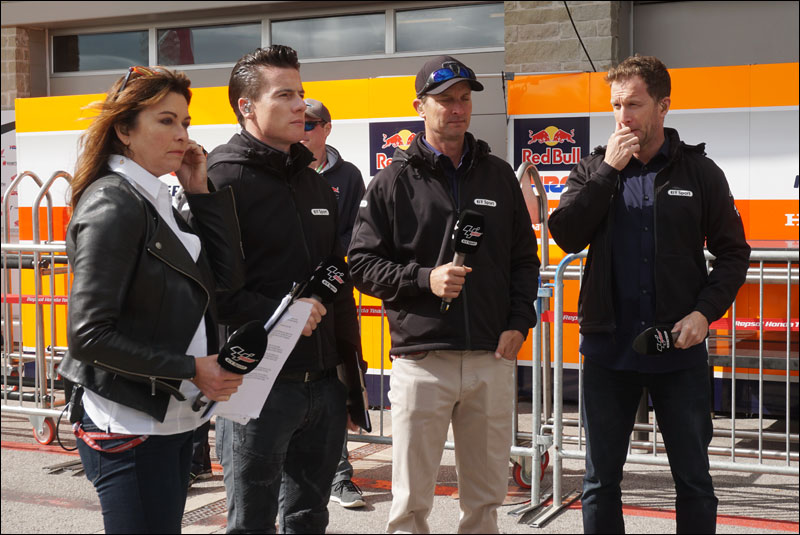 BT Sport's Suzi Perry with former Superbike world champions James Toseland, Colin Edwards, and Neil Hodgson prep before going on the air at the 2018 Grand Prix of the Americas