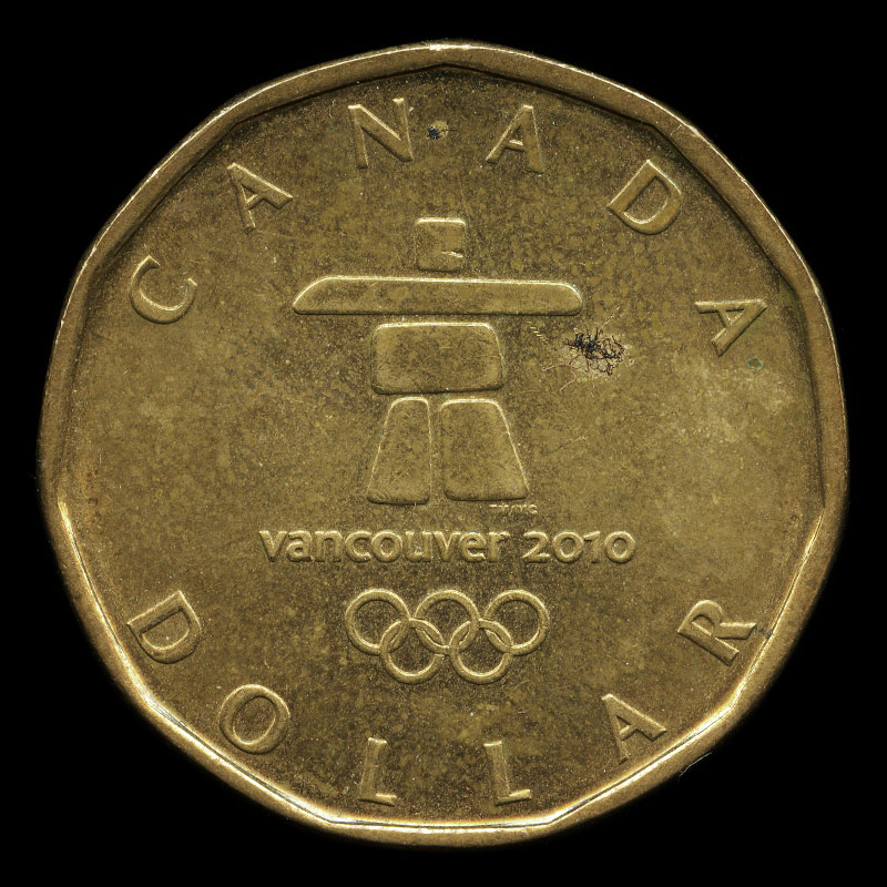 a commemorative Canadian one dollar coin featuring a portrait of Elizabeth II on one side and the logo for the 2010 Winter Olympics in Vancouver on the other