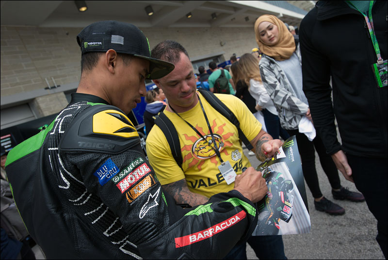 Malaysian MotoGP rider Hafizh Syahrin signs autographs for fans after qualifying at the 2018 Motorcycle Grand Prix of the Americas