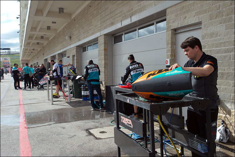 Moto2 teams hose down body panels after practice at the 2018 Grand Prix of the Americas