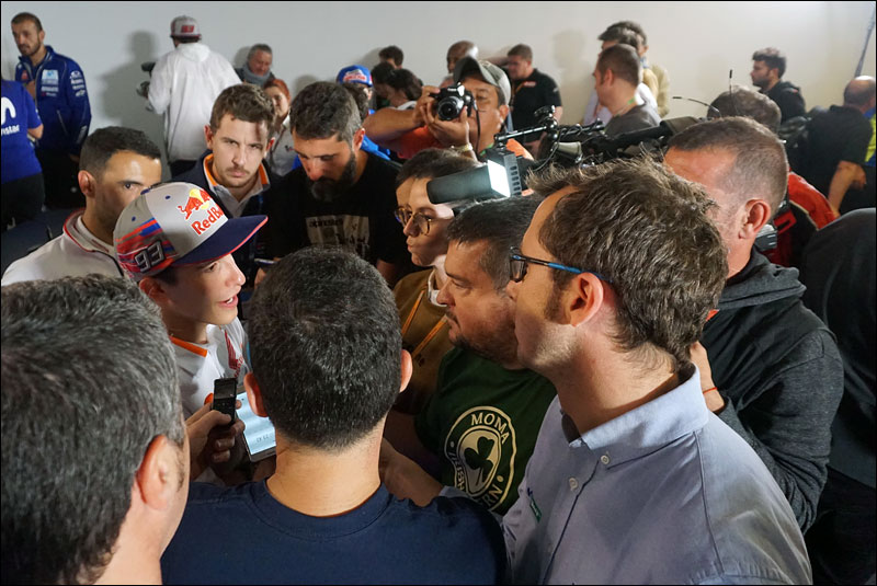 journalists crowd pole position winner Marc Márquez at the 2018 Motorcycle Grand Prix of the Americas