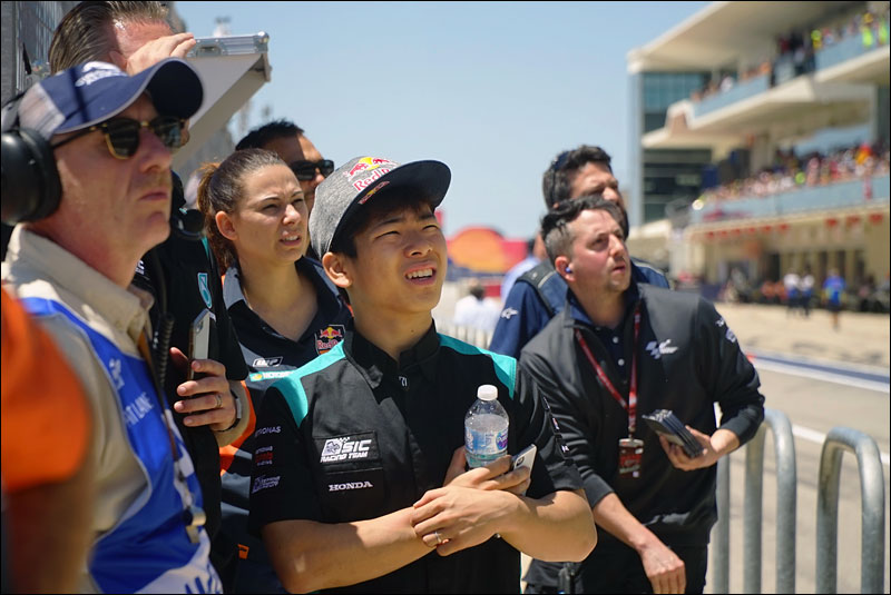 Japanese Moto3 rider Ayumu Sasaki watches the MotoGP race from the sidelines at the 2018 Grand Prix of the Americas