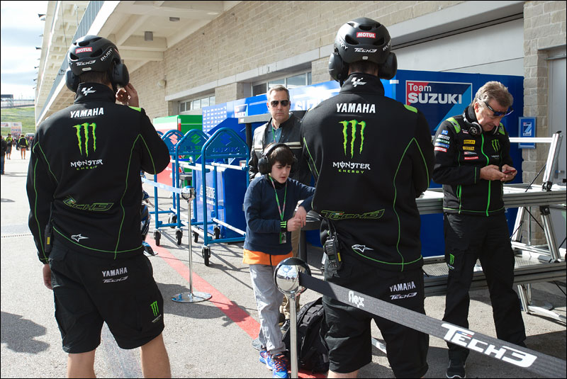 Tech3 Yamaha boss Hervé Poncharal (far right) and other crew members take a break after practice at the 2018 Grand Prix of the Americas