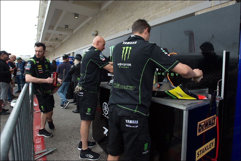 Tech3 Yamaha crew members clean up after practice at the 2018 Grand Prix of the Americas
