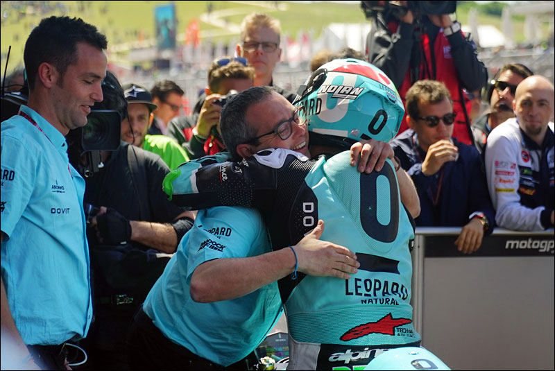 Italian Moto2 rider Enea Bastianini celebrates with his team after his victory at the 2018 Motorcycle Grand Prix of the Americas