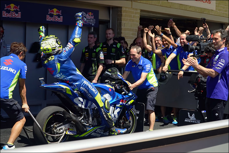 Italian MotoGP rider Andrea Iannone celebrates with his team after securing third place at the 2018 Motorcycle Grand Prix of the Americas